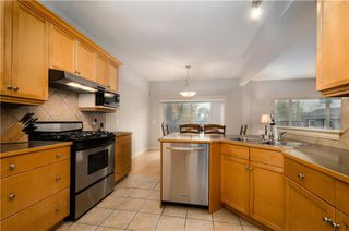 Photo 13: 242 STRATHRIDGE Place SW in Calgary: Strathcona Park Detached for sale : MLS®# C4246259