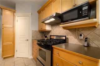 Photo 12: 242 STRATHRIDGE Place SW in Calgary: Strathcona Park Detached for sale : MLS®# C4246259