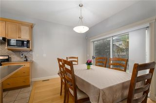 Photo 9: 242 STRATHRIDGE Place SW in Calgary: Strathcona Park Detached for sale : MLS®# C4246259