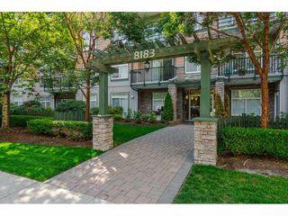 "Photo 2: 112 8183 121A Street in Surrey: Queen Mary Park Surrey Condo for sale in ""Celeste"" : MLS®# R2404463"