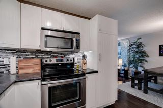 Photo 10: 7 12625 24 Street SW in Calgary: Woodbine Row/Townhouse for sale : MLS®# A1012796