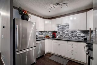 Photo 9: 7 12625 24 Street SW in Calgary: Woodbine Row/Townhouse for sale : MLS®# A1012796
