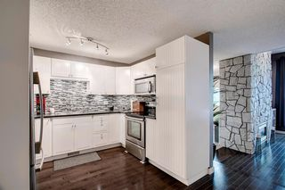 Photo 7: 7 12625 24 Street SW in Calgary: Woodbine Row/Townhouse for sale : MLS®# A1012796