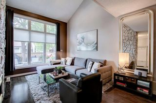 Photo 2: 7 12625 24 Street SW in Calgary: Woodbine Row/Townhouse for sale : MLS®# A1012796