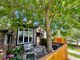 Photo 1: 7 12625 24 Street SW in Calgary: Woodbine Row/Townhouse for sale : MLS®# A1012796