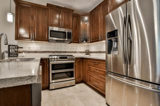 """Photo 1: A307 20716 WILLOUGHBY TOWN CENTRE Drive in Langley: Willoughby Heights Condo for sale in """"Yorkson Downs"""" : MLS®# R2476051"""
