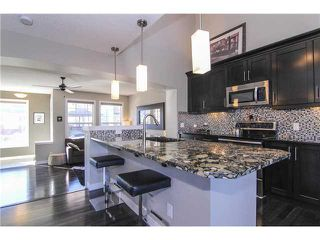 Photo 2: 48 AUBURN BAY Crescent SE in Calgary: Auburn Bay Residential Detached Single Family for sale : MLS®# C3636481