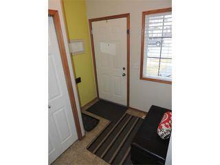 Photo 2: 1056 EVERRIDGE Drive SW in Calgary: Evergreen House for sale : MLS®# C4005156