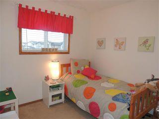Photo 14: 1056 EVERRIDGE Drive SW in Calgary: Evergreen House for sale : MLS®# C4005156