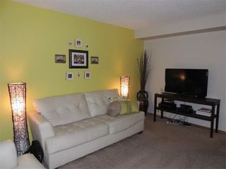 Photo 4: 1056 EVERRIDGE Drive SW in Calgary: Evergreen House for sale : MLS®# C4005156