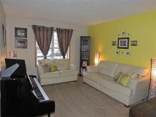 Photo 3: 1056 EVERRIDGE Drive SW in Calgary: Evergreen House for sale : MLS®# C4005156