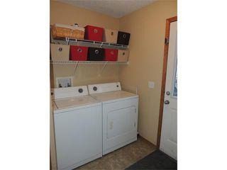 Photo 9: 1056 EVERRIDGE Drive SW in Calgary: Evergreen House for sale : MLS®# C4005156