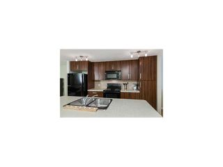 Photo 6: 115 McKenzie Towne Close E in Calgary: McKenzie Towne House for sale : MLS®# C4021755