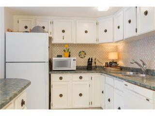 Photo 9: 15 2225 OAKMOOR Drive SW in Calgary: Palliser House for sale : MLS®# C4092246