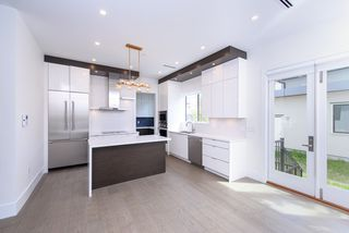 Photo 4: 7250 GLADSTONE Street in Vancouver: Fraserview VE House for sale (Vancouver East)  : MLS®# R2372481
