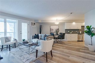 Photo 2: 422 7229 SIERRA MORENA Boulevard SW in Calgary: Signal Hill Apartment for sale : MLS®# C4272380