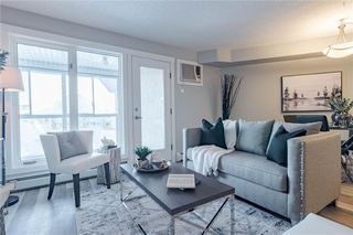 Photo 3: 422 7229 SIERRA MORENA Boulevard SW in Calgary: Signal Hill Apartment for sale : MLS®# C4272380