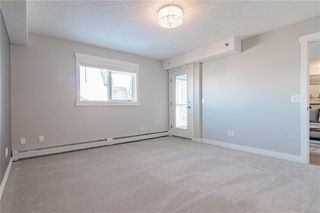 Photo 21: 422 7229 SIERRA MORENA Boulevard SW in Calgary: Signal Hill Apartment for sale : MLS®# C4272380