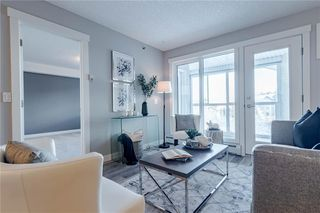 Photo 5: 422 7229 SIERRA MORENA Boulevard SW in Calgary: Signal Hill Apartment for sale : MLS®# C4272380