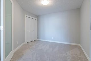 Photo 32: 422 7229 SIERRA MORENA Boulevard SW in Calgary: Signal Hill Apartment for sale : MLS®# C4272380