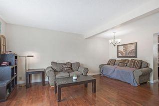 Photo 7: 21 Erin Ridge Road SE in Calgary: Erin Woods Detached for sale : MLS®# A1052761