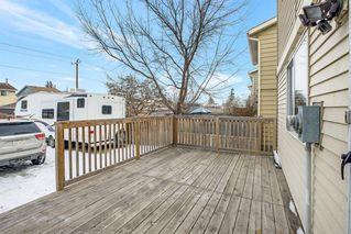 Photo 5: 21 Erin Ridge Road SE in Calgary: Erin Woods Detached for sale : MLS®# A1052761
