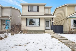 Photo 1: 21 Erin Ridge Road SE in Calgary: Erin Woods Detached for sale : MLS®# A1052761
