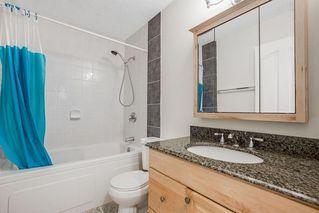 Photo 18: 21 Erin Ridge Road SE in Calgary: Erin Woods Detached for sale : MLS®# A1052761