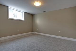 Photo 16: 10655 Mapleglen Cres SE in Calgary: House for sale : MLS®# C3626899
