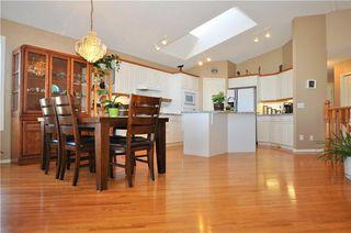 Photo 8: 169 ROCKY RIDGE Cove NW in Calgary: Rocky Ridge House for sale : MLS®# C4140568