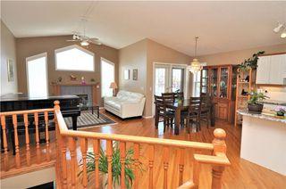 Photo 7: 169 ROCKY RIDGE Cove NW in Calgary: Rocky Ridge House for sale : MLS®# C4140568