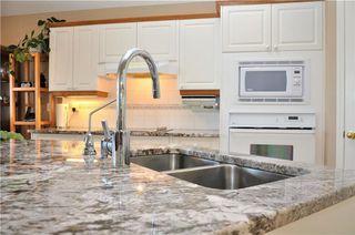 Photo 6: 169 ROCKY RIDGE Cove NW in Calgary: Rocky Ridge House for sale : MLS®# C4140568