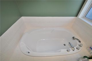 Photo 18: 169 ROCKY RIDGE Cove NW in Calgary: Rocky Ridge House for sale : MLS®# C4140568