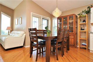 Photo 9: 169 ROCKY RIDGE Cove NW in Calgary: Rocky Ridge House for sale : MLS®# C4140568