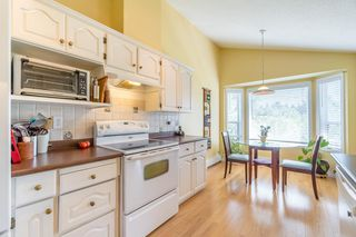 """Photo 8: 61 5216 201A Street in Langley: Langley City Townhouse for sale in """"MEADOWVIEW ESTATES"""" : MLS®# R2300579"""