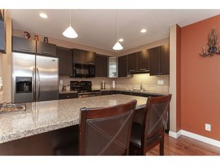 "Photo 2: 103 5474 198 Street in Langley: Langley City Condo for sale in ""Southbrook"" : MLS®# R2327268"