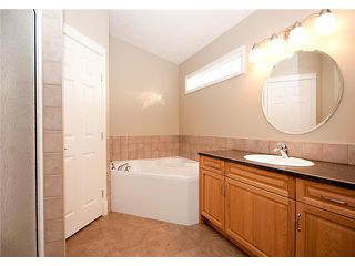 Photo 12: 193 CRAWFORD Drive W: Cochrane Residential Attached for sale : MLS®# C3505616