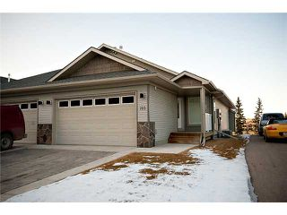 Photo 1: 193 CRAWFORD Drive W: Cochrane Residential Attached for sale : MLS®# C3505616
