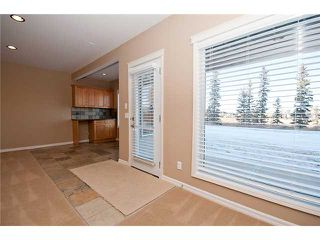 Photo 16: 193 CRAWFORD Drive W: Cochrane Residential Attached for sale : MLS®# C3505616