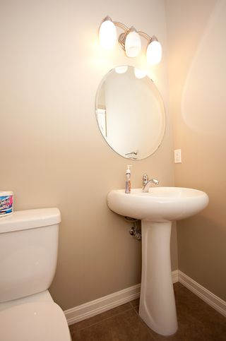 Photo 3: 193 CRAWFORD Drive W: Cochrane Residential Attached for sale : MLS®# C3505616
