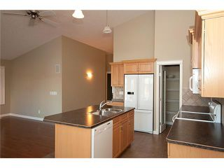 Photo 6: 193 CRAWFORD Drive W: Cochrane Residential Attached for sale : MLS®# C3505616