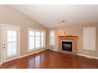 Photo 8: 193 CRAWFORD Drive W: Cochrane Residential Attached for sale : MLS®# C3505616