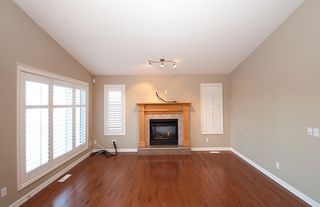 Photo 10: 193 CRAWFORD Drive W: Cochrane Residential Attached for sale : MLS®# C3505616