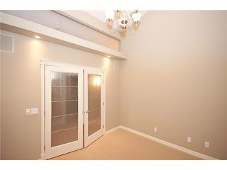 Photo 4: 193 CRAWFORD Drive W: Cochrane Residential Attached for sale : MLS®# C3505616