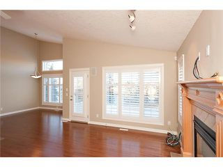 Photo 9: 193 CRAWFORD Drive W: Cochrane Residential Attached for sale : MLS®# C3505616