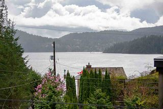 Photo 1: 5581 INDIAN RIVER Drive in North Vancouver: Woodlands-Sunshine-Cascade House for sale : MLS®# R2257797