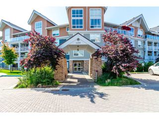 "Photo 1: 211 6480 194 Street in Surrey: Clayton Condo for sale in ""Waterstone"" (Cloverdale)  : MLS®# R2281179"