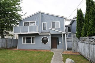 Photo 1: 765 CLARKE Road in Coquitlam: Coquitlam West House 1/2 Duplex for sale : MLS®# R2374397