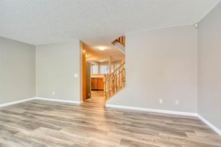 Photo 5: 6 LINCOLN Green SW in Calgary: Lincoln Park Row/Townhouse for sale : MLS®# A1026784