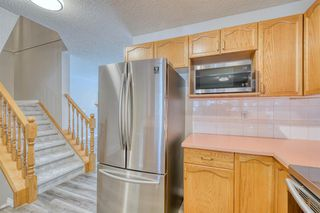 Photo 8: 6 LINCOLN Green SW in Calgary: Lincoln Park Row/Townhouse for sale : MLS®# A1026784